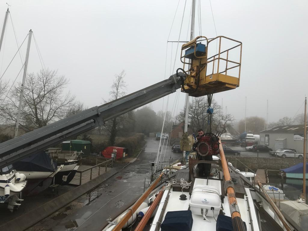 Boleh's volunteer Skippers will not be sorry to wave goodbye to the Beta, seen here being lifted out of the main hatch. Refit plans schedule mid-March for installation of the new generator.