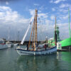 Boleh and volunteer crew putting out the bunting on return to her Haslar berth.