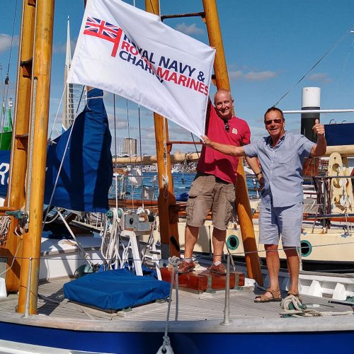 Mark and Chris onboard with the Flag